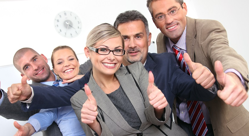 5 employees in business attire giving the thumbs up to their boss.